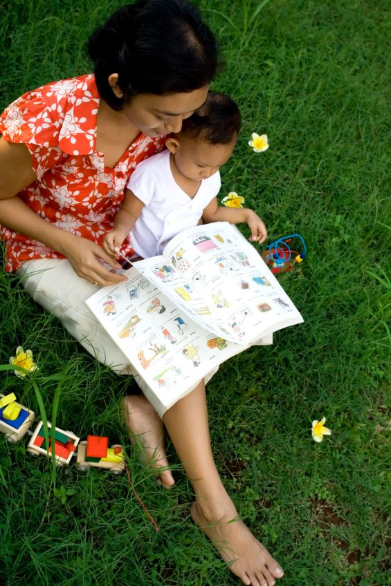 Mom reads with small child